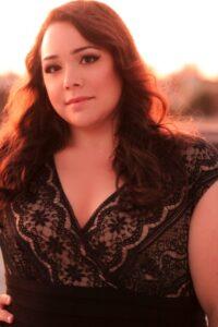 Maria Pendolino wearing a black dress at sunset